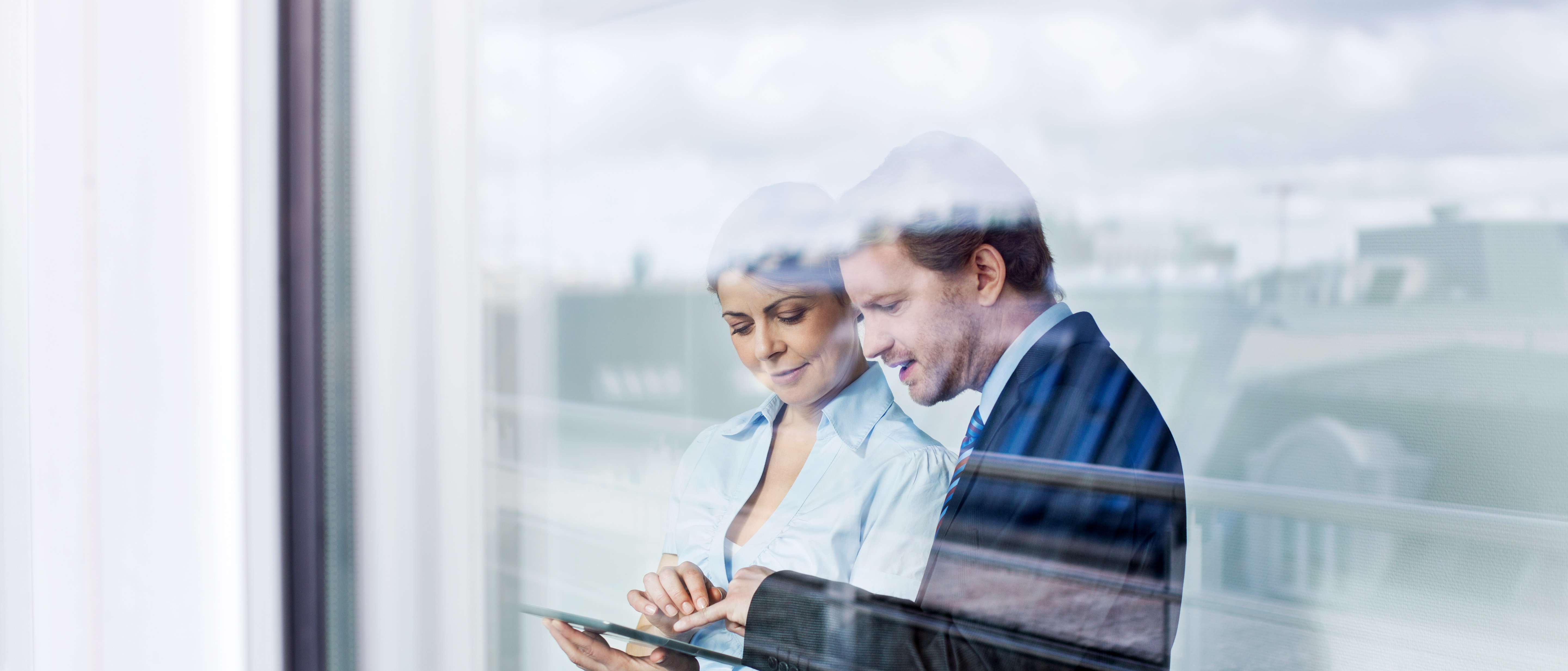 man and woman looking at tablet foto istock